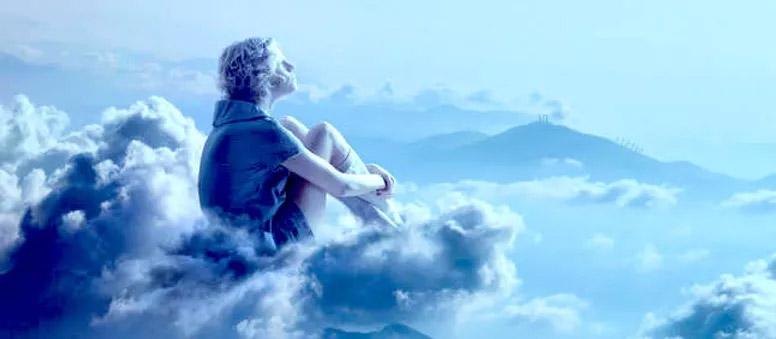 Personne qui songe dans les nuages